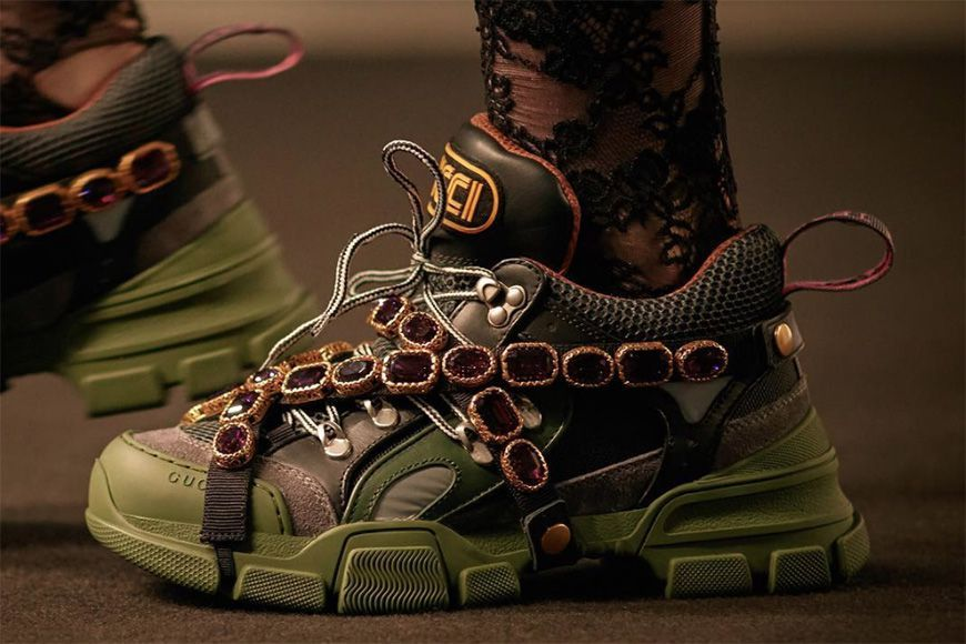 pair of chunky sneakers with crystals