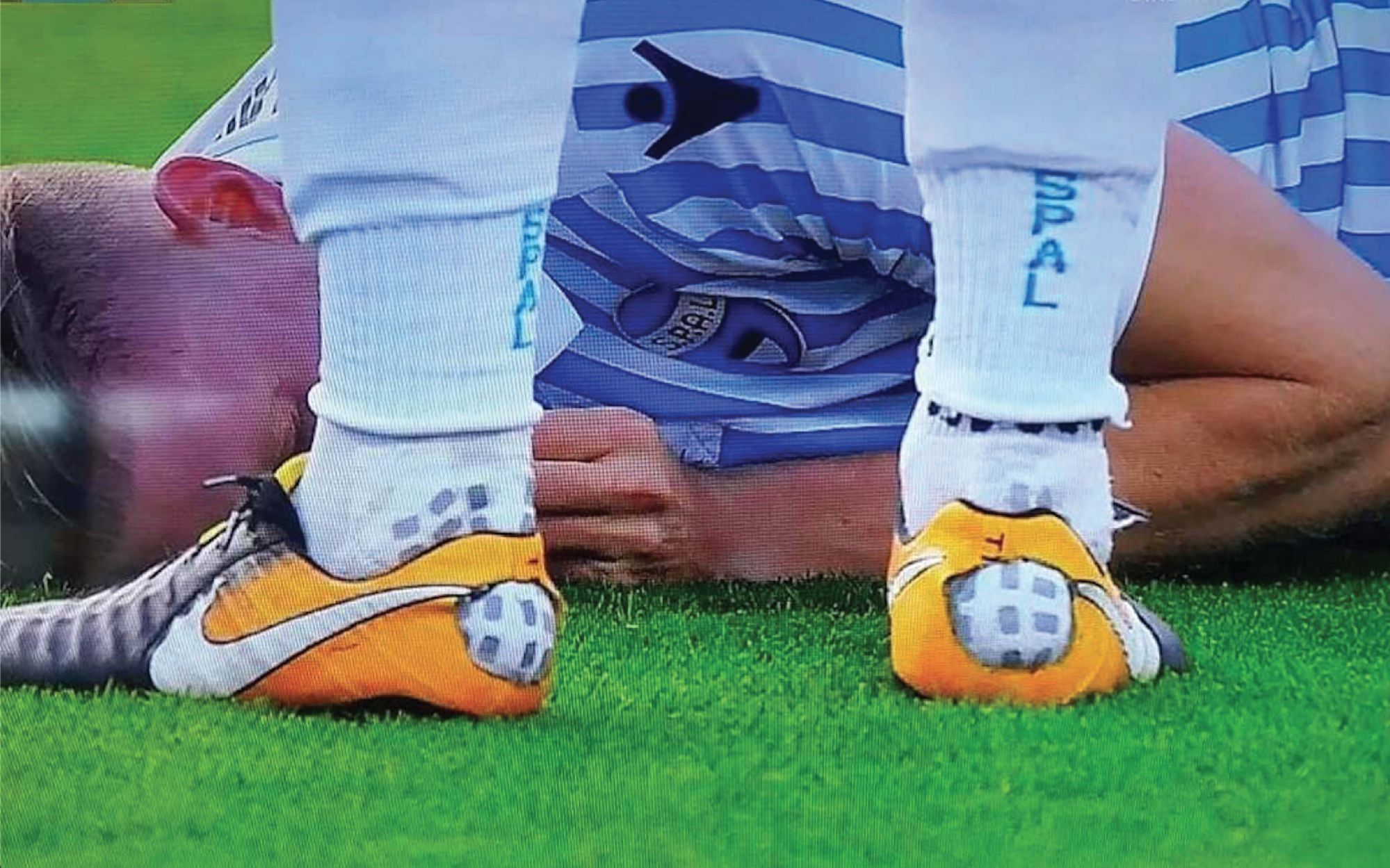 Why do football players cut their shoes?
